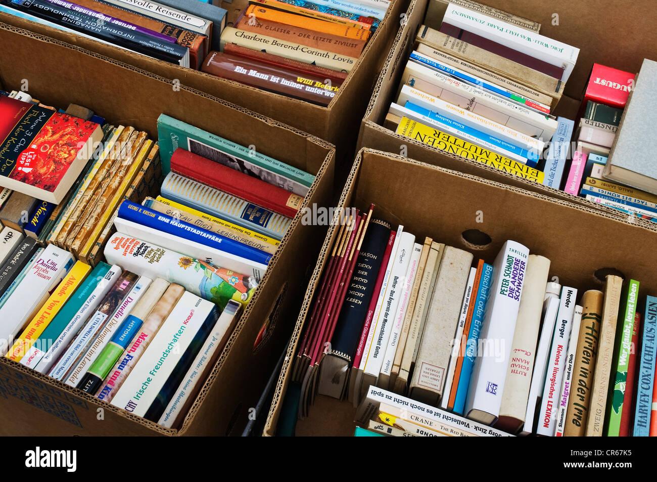 Book flea market, boxes of fiction books, PublicGround - Stock Image
