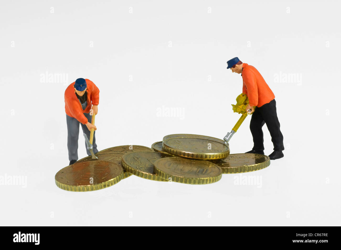 Miniature figures of construction workers with a pickaxe and a jackhammer working on a pile of euro coins, symbolic - Stock Image