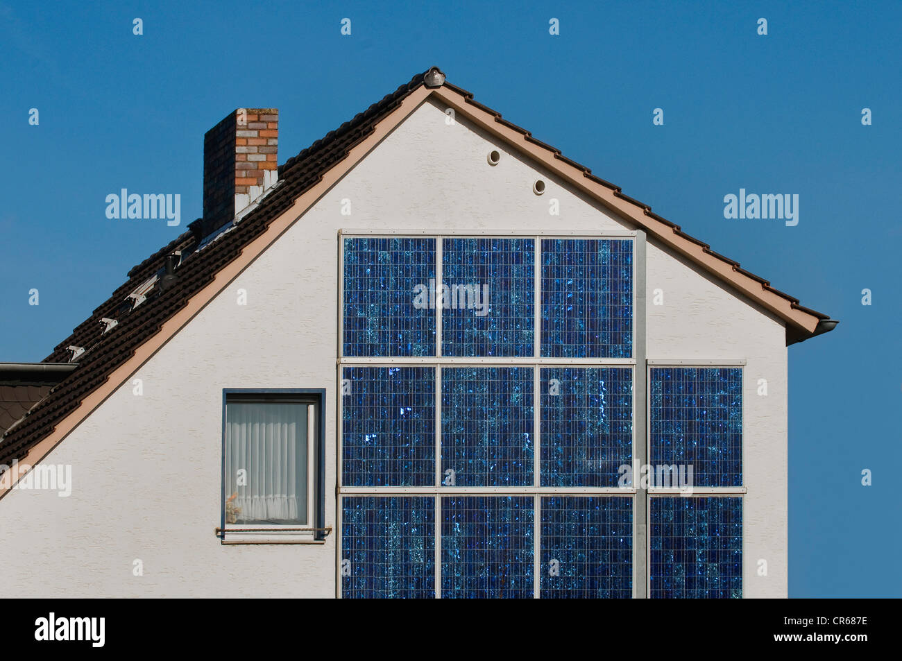 Modernised single-family home with solar panels on the southern wall, energy turnaround, PublicGround - Stock Image