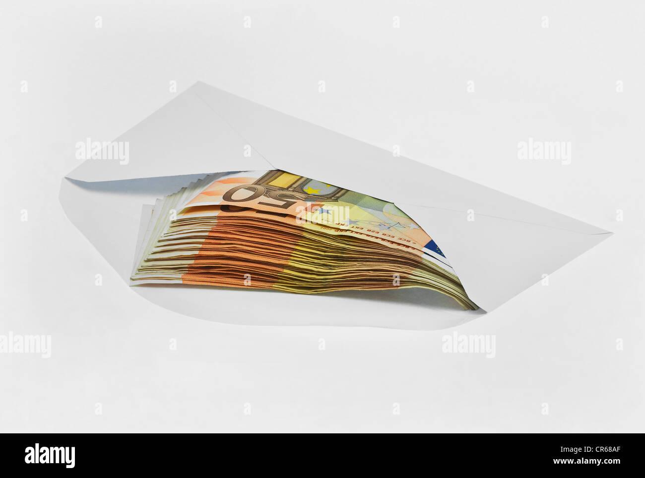 Envelope with 50-euro banknotes, bribe money, black money - Stock Image