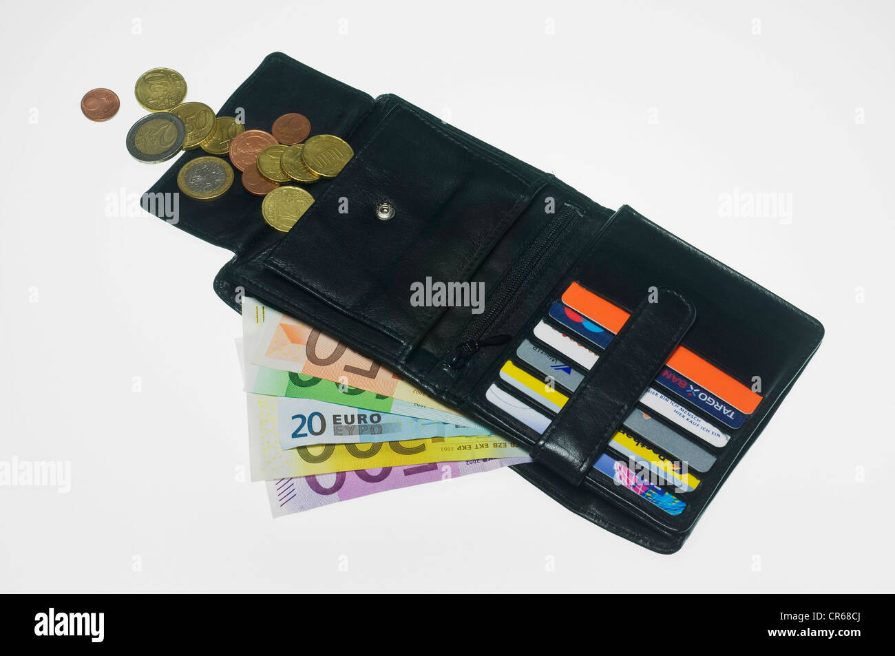 Open wallet with euro banknotes, coins and card compartments - Stock Image
