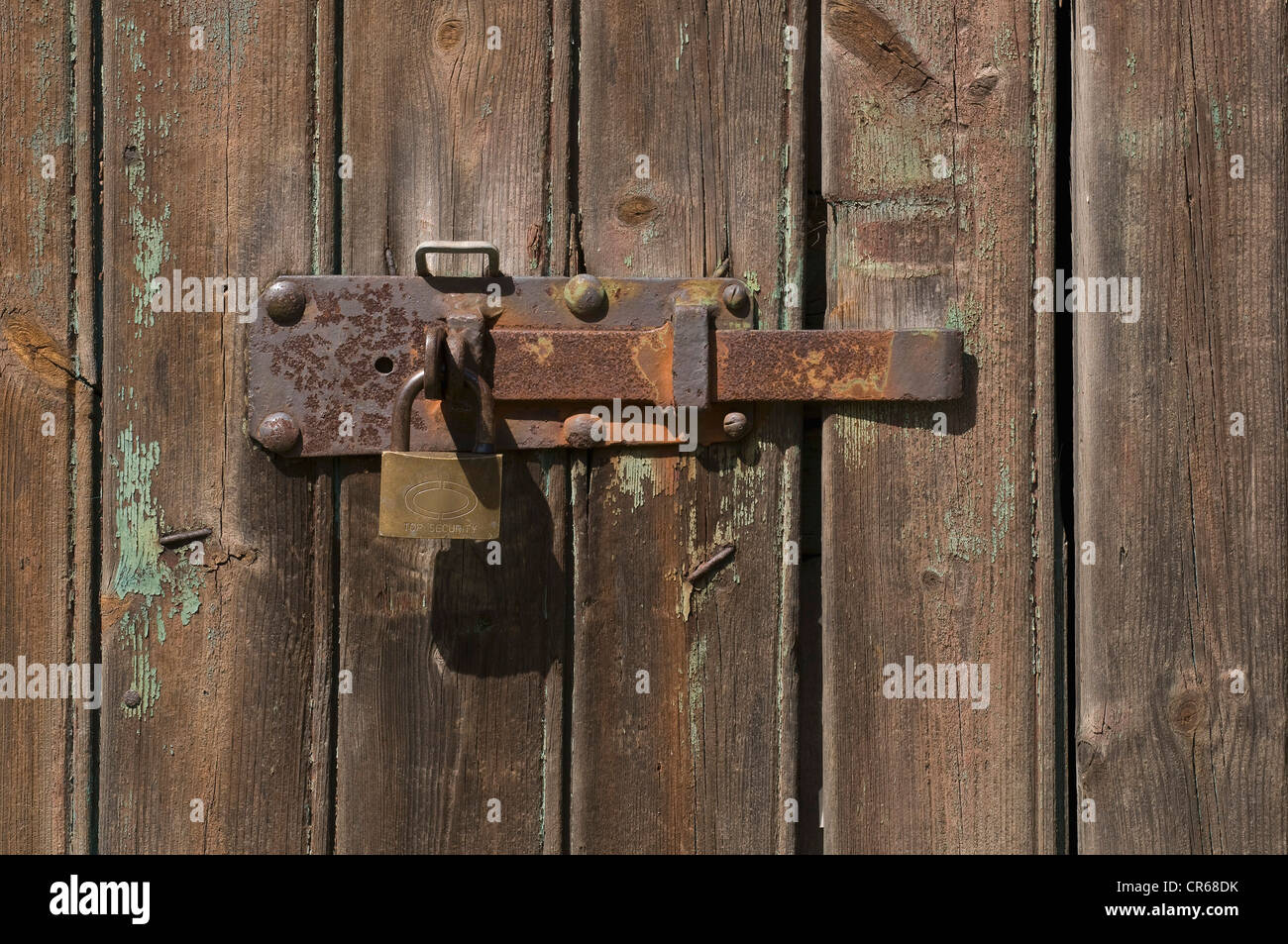 Rusty metal latch on a shed door - Stock Image