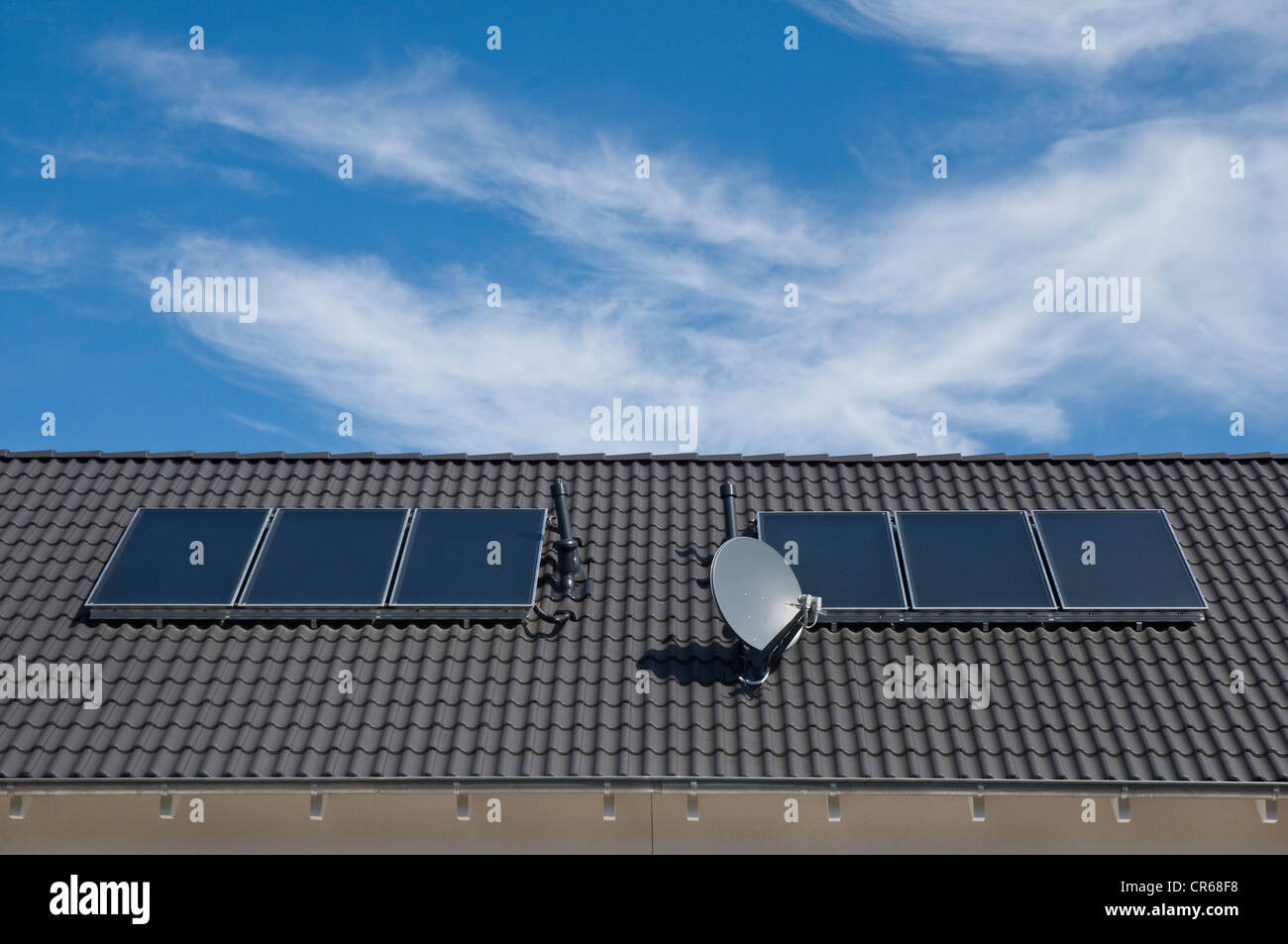 Solar panels to heat water, absorption areas on a roof of an apartment building, PublicGround - Stock Image