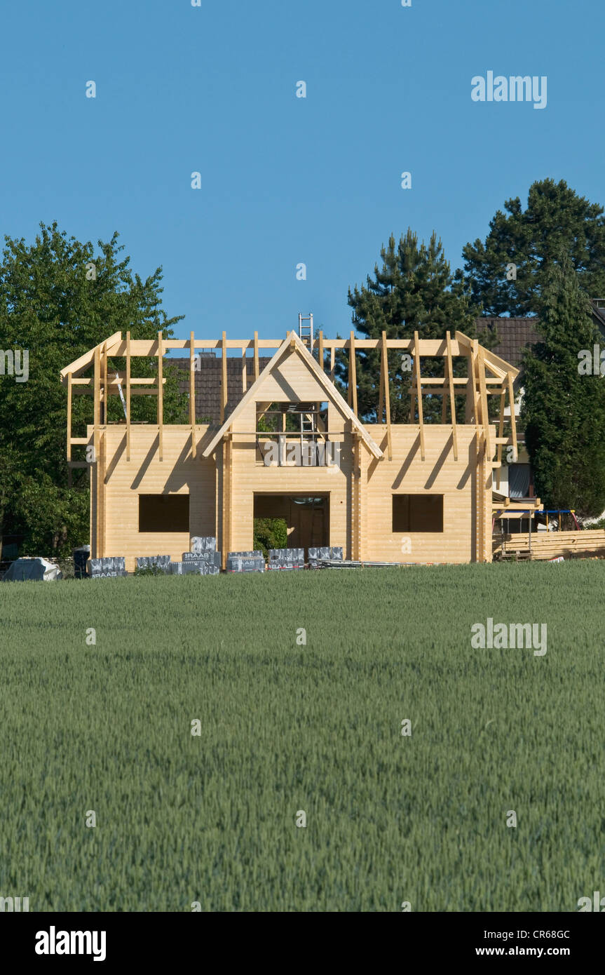 New construction, wooden house, roof under construction, PublicGround - Stock Image
