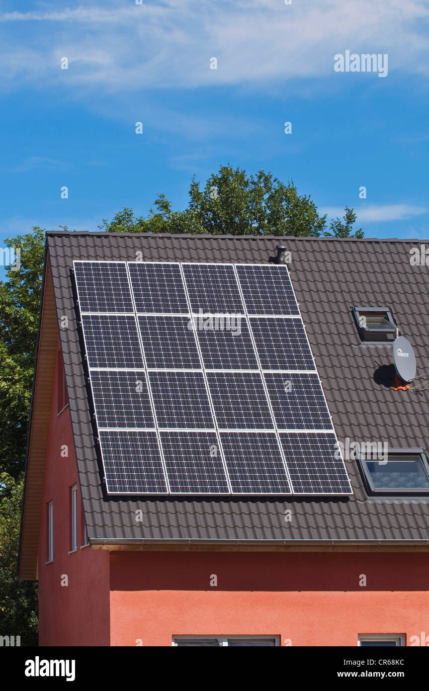 Solar panels on the roof of a residential house, PublicGround - Stock Image