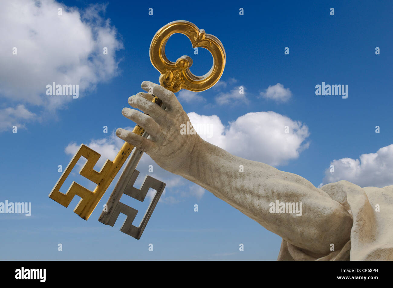 Arm of St. Peter with the key of heaven in front of a cloudy blue sky, Salzburg Cathedral, UNESCO World Heritage - Stock Image