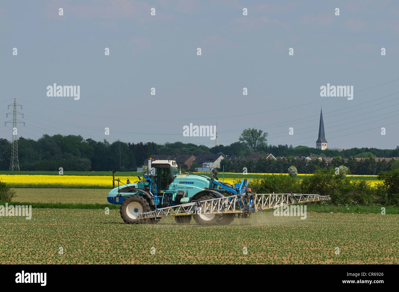 Self-propelled sprayer in use on field of beet, plant protection, agriculture - Stock Image