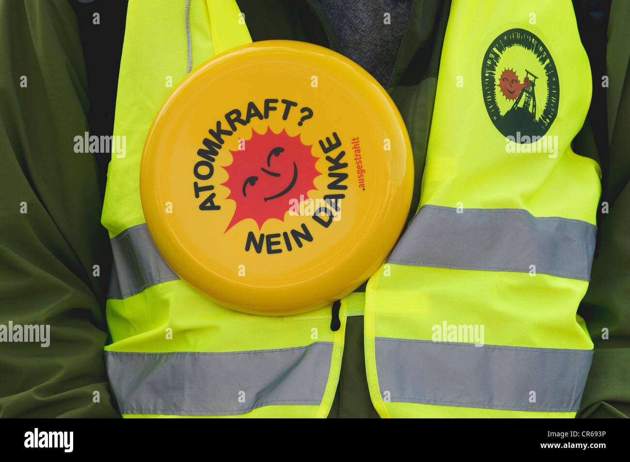 Anti-nuclear protester wearing a waistcoast, 'Atomkraft? Nein danke', German for 'nuclear power, no - Stock Image