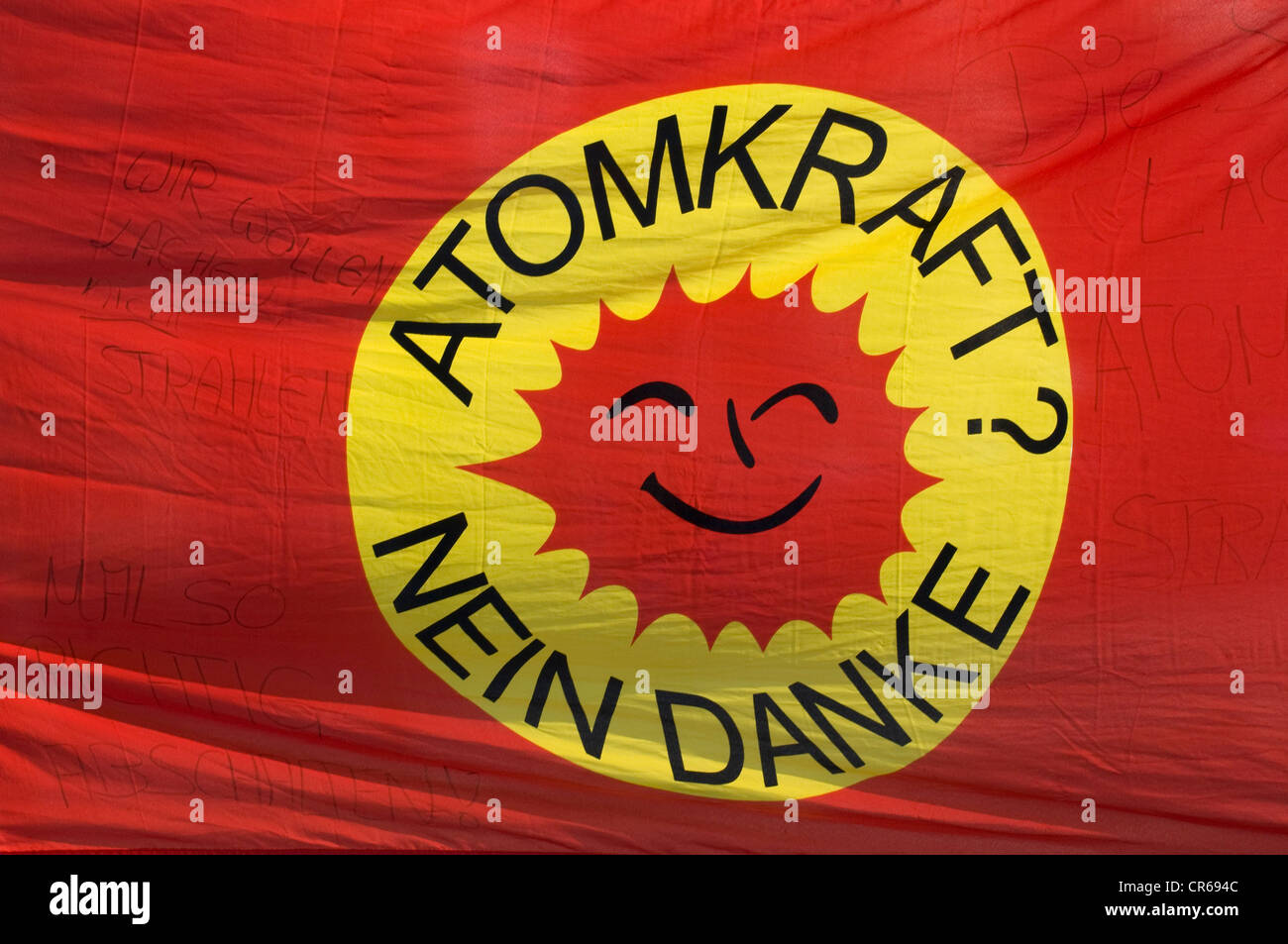 """Banner """"Atomkraft? Nein danke"""" German for """"nuclear power? No thanks"""", smiling sun, logo of the anti-nuclear movement Stock Photo"""