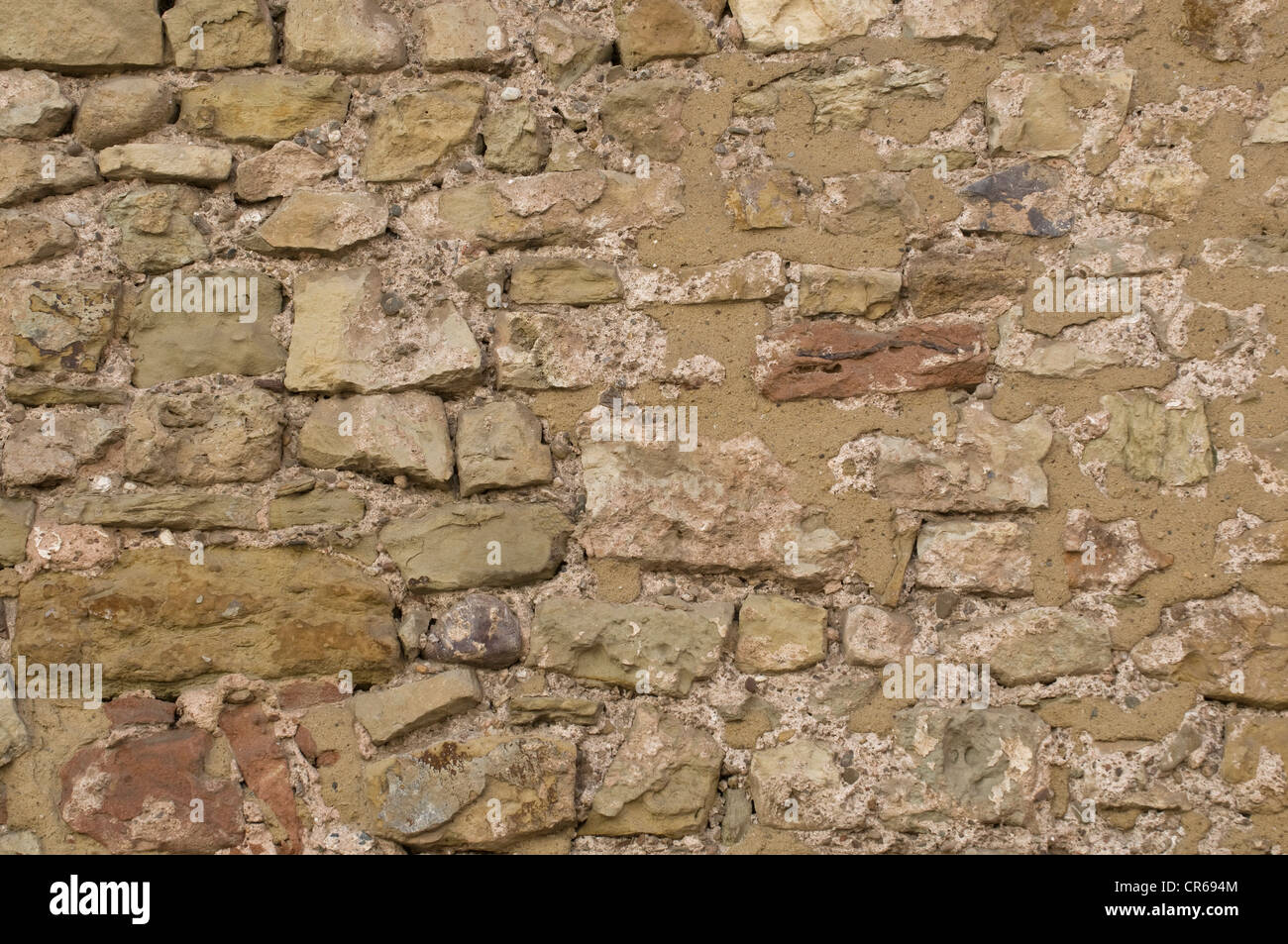 Mended natural stone wall - Stock Image