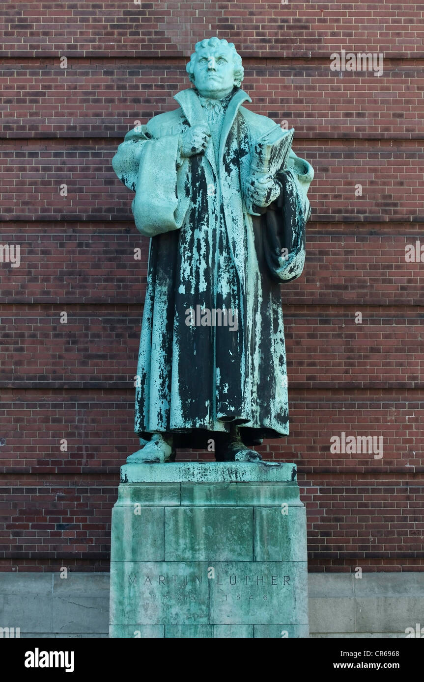 Bronze statue of Martin Luther, reformer holding the new bible, Hamburg, Germany, Europe - Stock Image