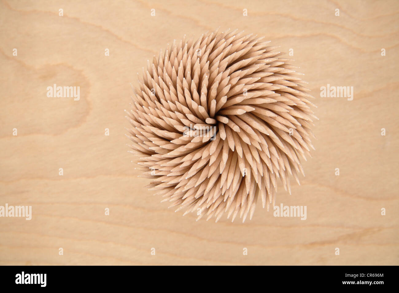 Tooth pick bundle on wooden table, close up - Stock Image