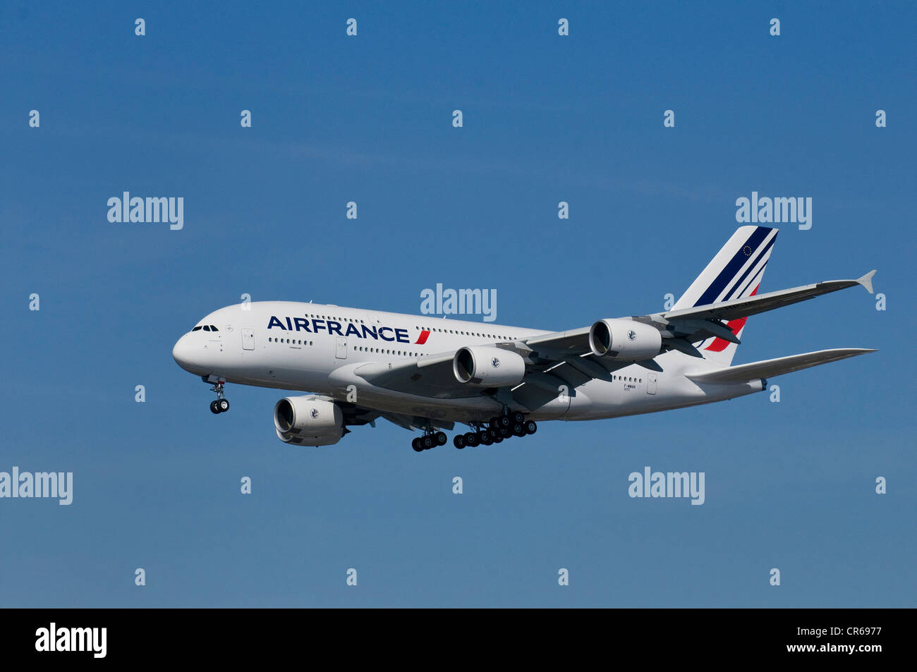 Air France passenger plane in flight with extended landing gear, Airbus A 380 super jumbo - Stock Image