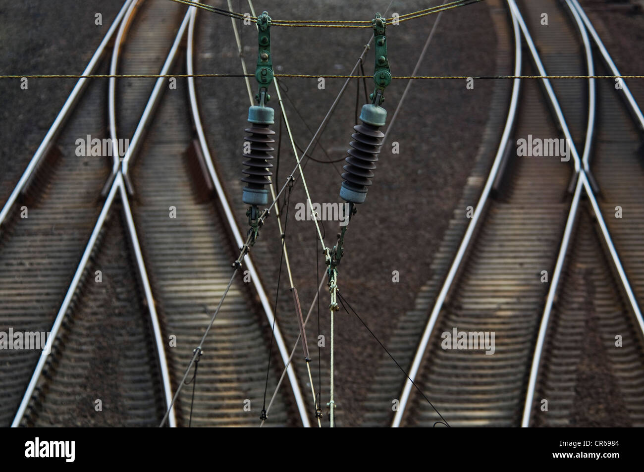 Railway tracks and overhead power lines, switches, rail traffic - Stock Image