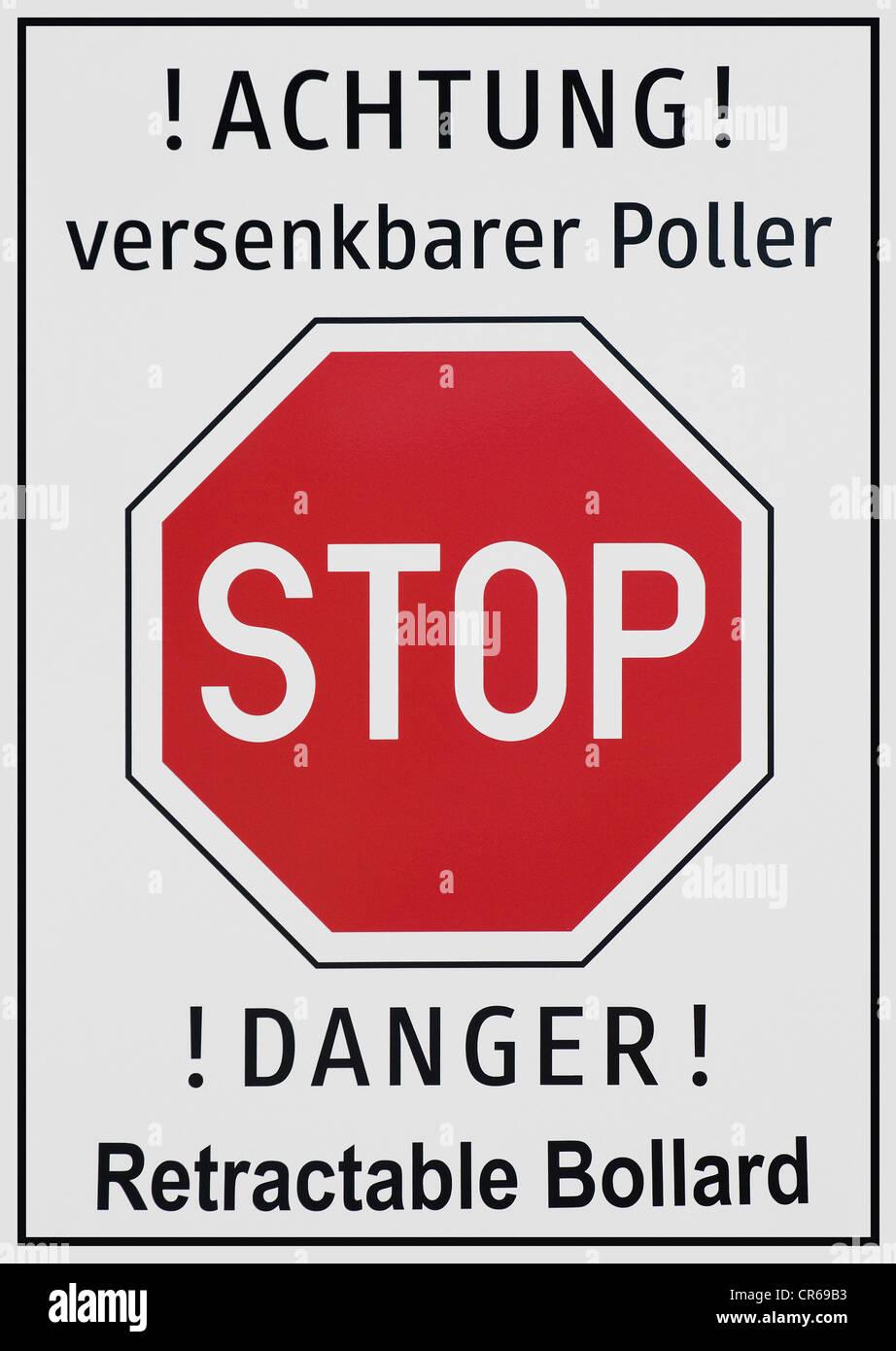 Achtung versenkbarer Poller or Danger, retractable bollard, warning sign - Stock Image