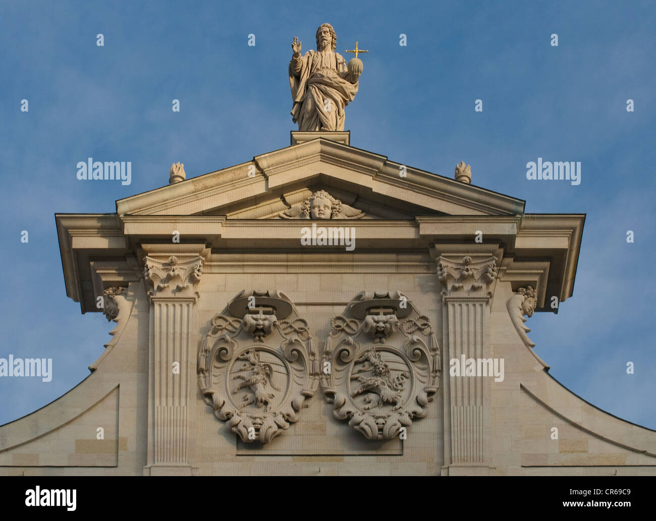 Christus Salvator in the evening light, gabled west facade of Salzburg Cathedral, including the coats-of-arms of - Stock Image