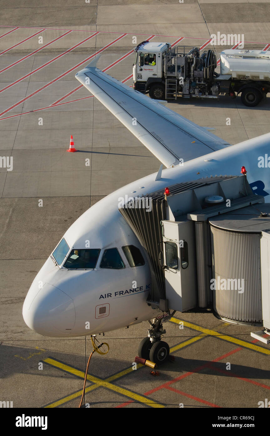 Air France aircraft attached to a gangway, in front of a tanker, Duesseldorf International Airport, North Rhine - Stock Image