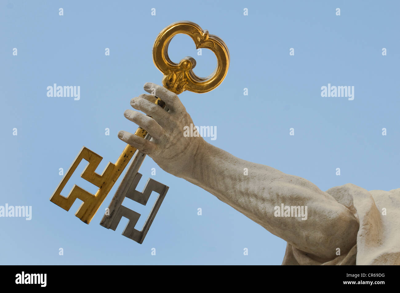 St. Peter holding the Keys of Heaven, detail, hand with 2 keys, in front of Salzburg Cathedral, UNESCO World Heritage - Stock Image