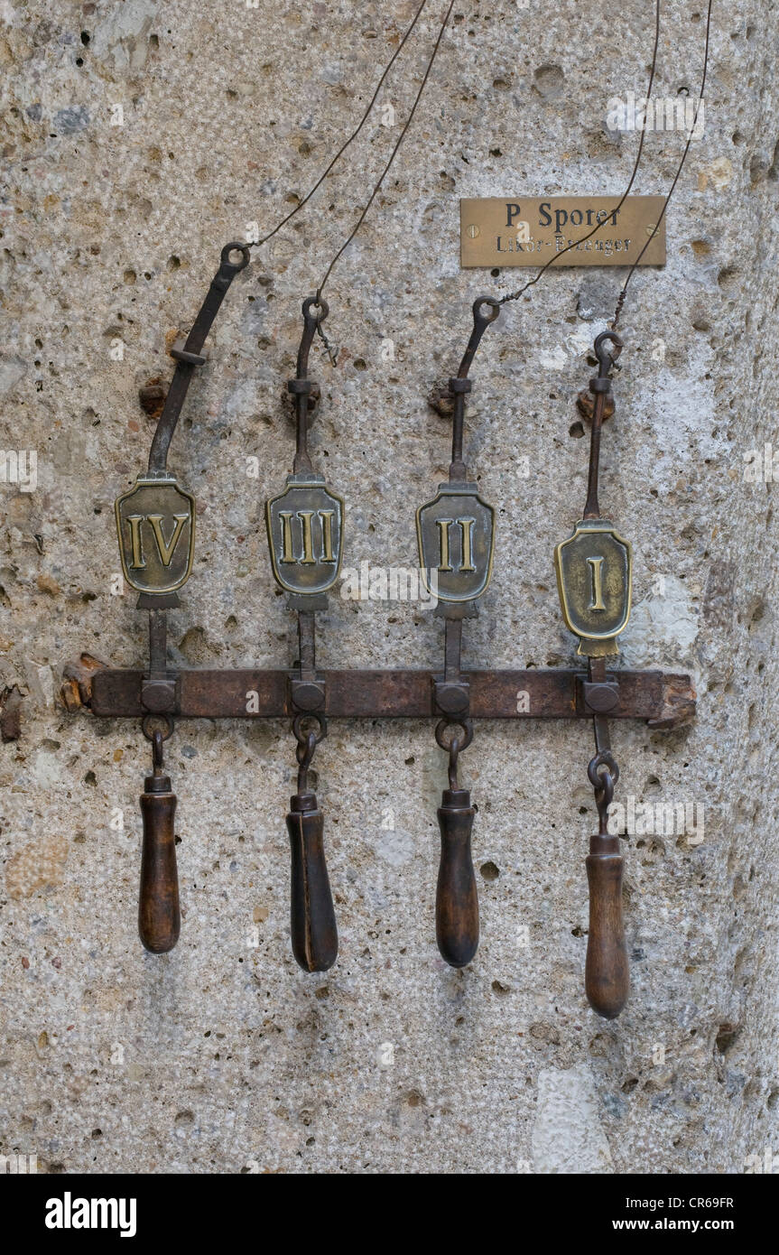 Four historic pull-cables for doorbells, Haus Sporer Likoer, Getreidegasse, Salzburg, UNESCO World Heritage Site, - Stock Image