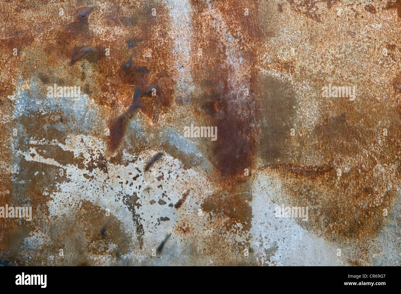 Metal plate with rust and paint stains, background - Stock Image