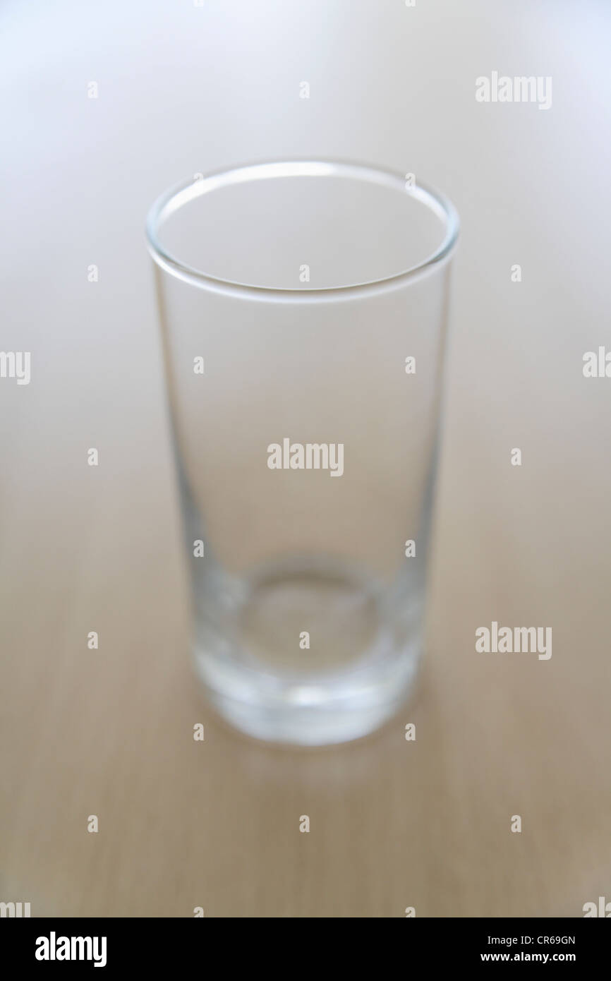 Empty glass on wooden table, close up - Stock Image