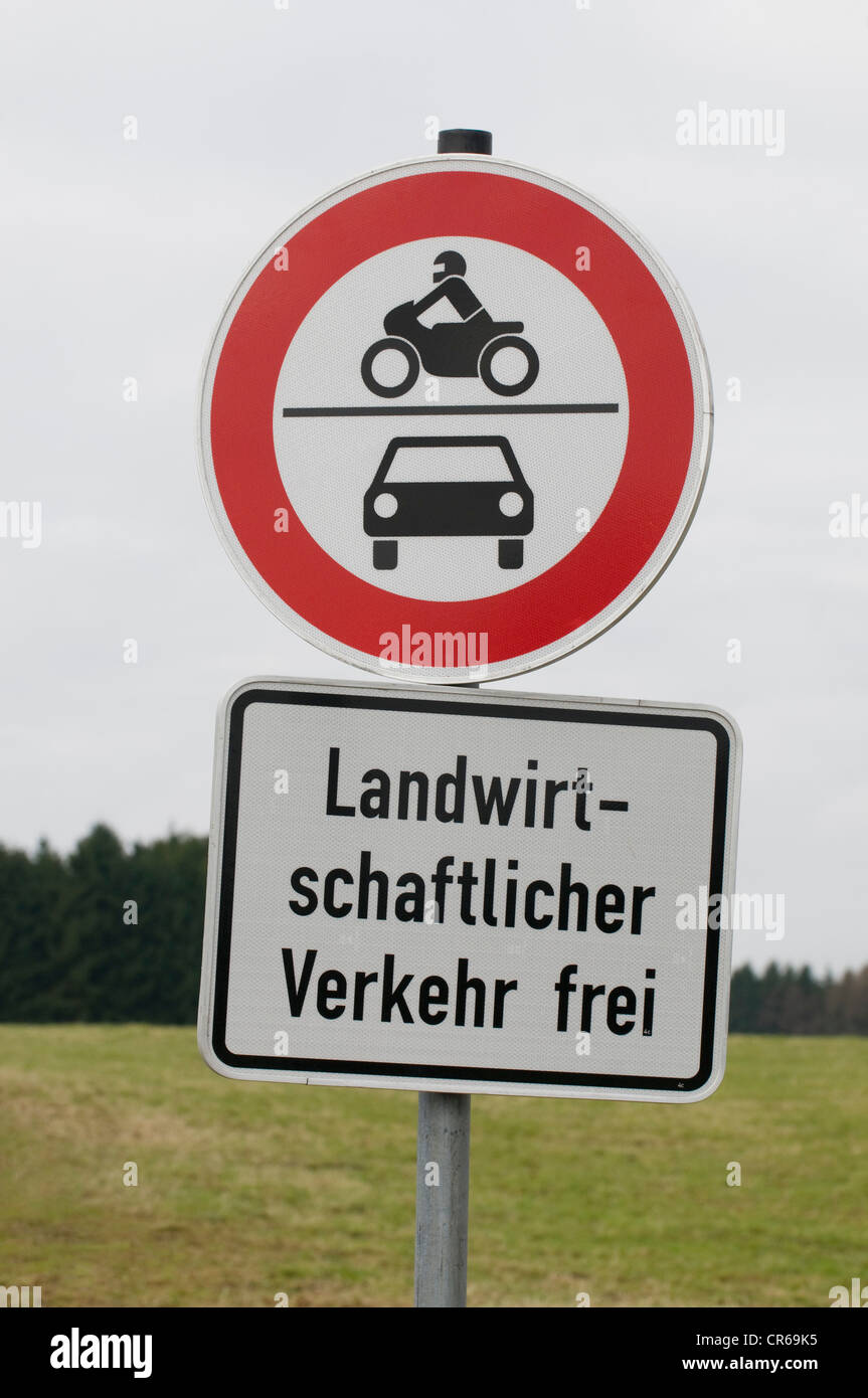Signs, driving ban for motorcycles and cars, agricultural vehicles may proceed - Stock Image