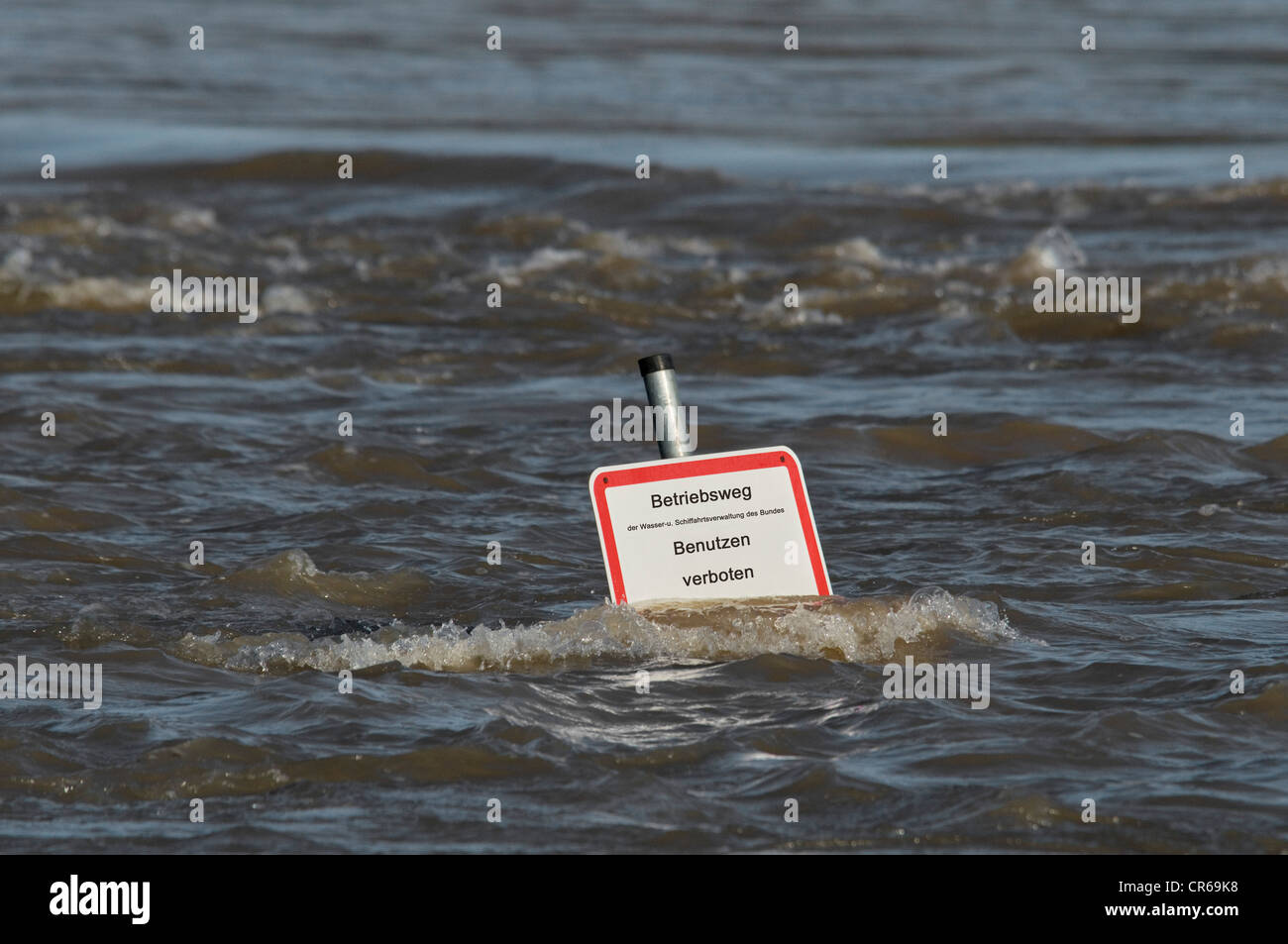 Flood, sign standing deep in the water, operating path of the Federal Water and Shipping Administration, use prohibited - Stock Image