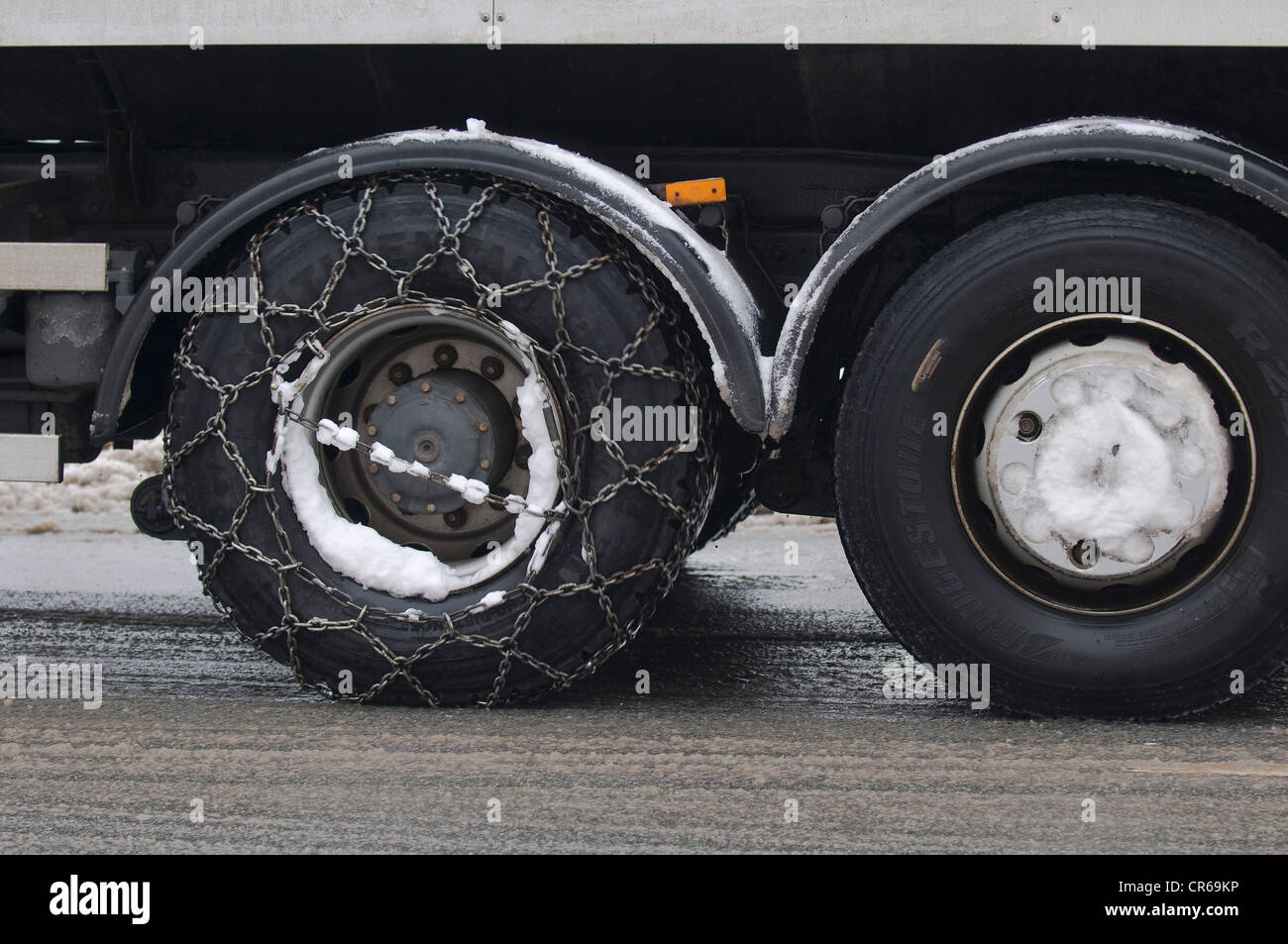 Winter, truck with snow chains on the drive axle - Stock Image