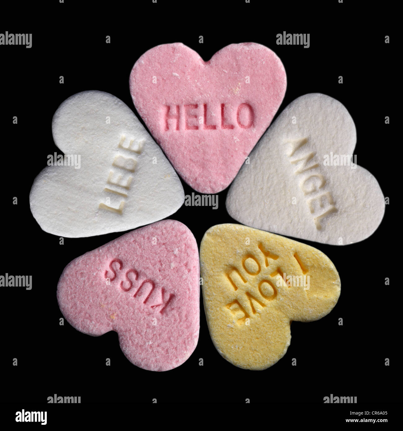 Heart candies with text on black background - Stock Image