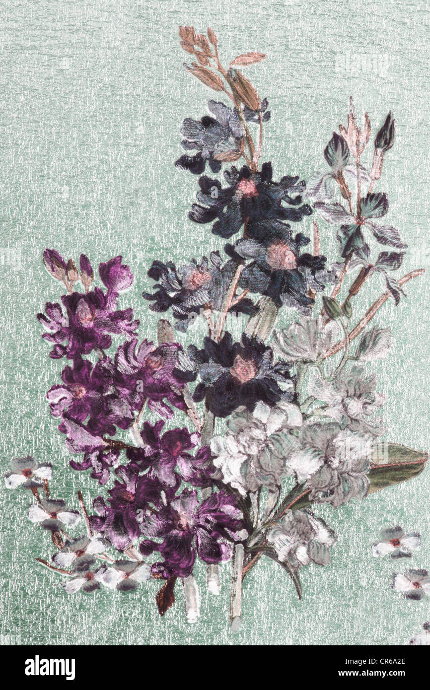 Floral design on glimmering paper, close up - Stock Image