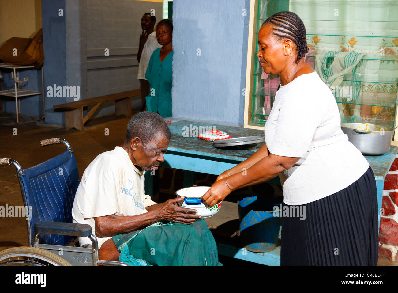 A sick man gets food in the tuberculosis and leprosy station, Manyemen, Cameroon, Africa - Stock Image