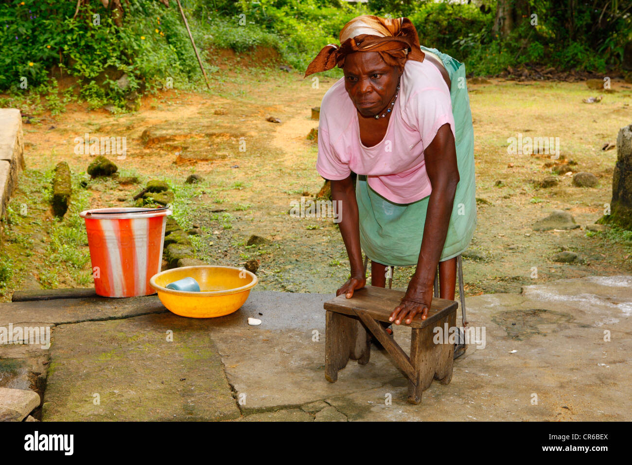 Leper using stool as walker, TB and leprosy centre, Manyemen, Cameroon, Africa - Stock Image
