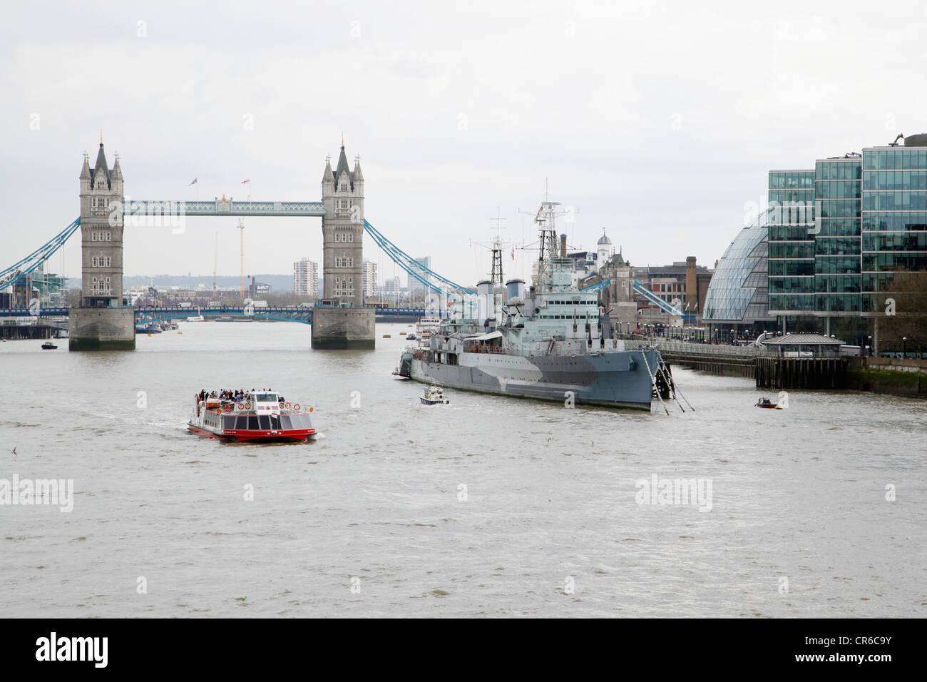 England, London, View of London bridge and navy ship - Stock Image