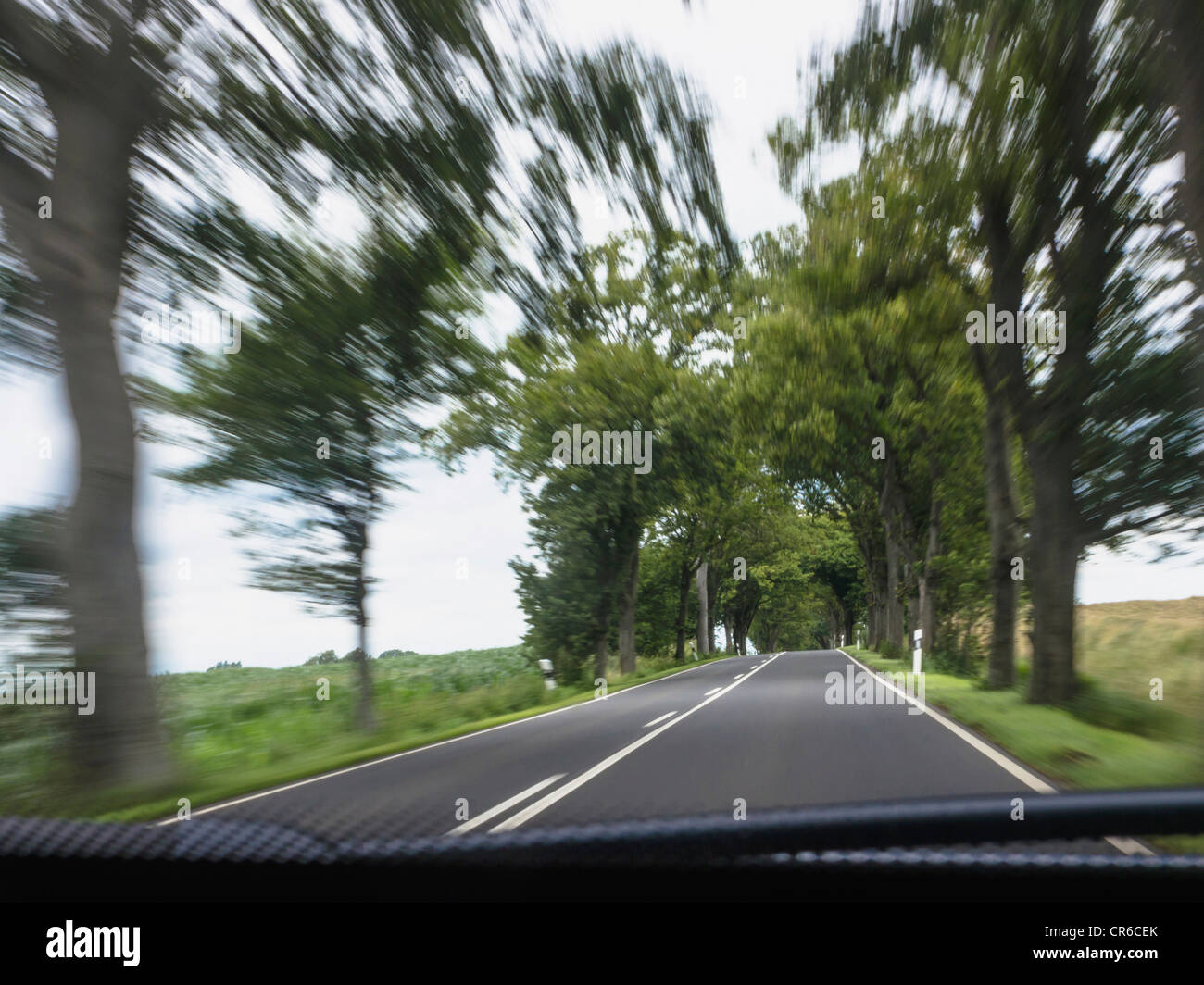 Northern Germany, Vehicle in blurred motion - Stock Image