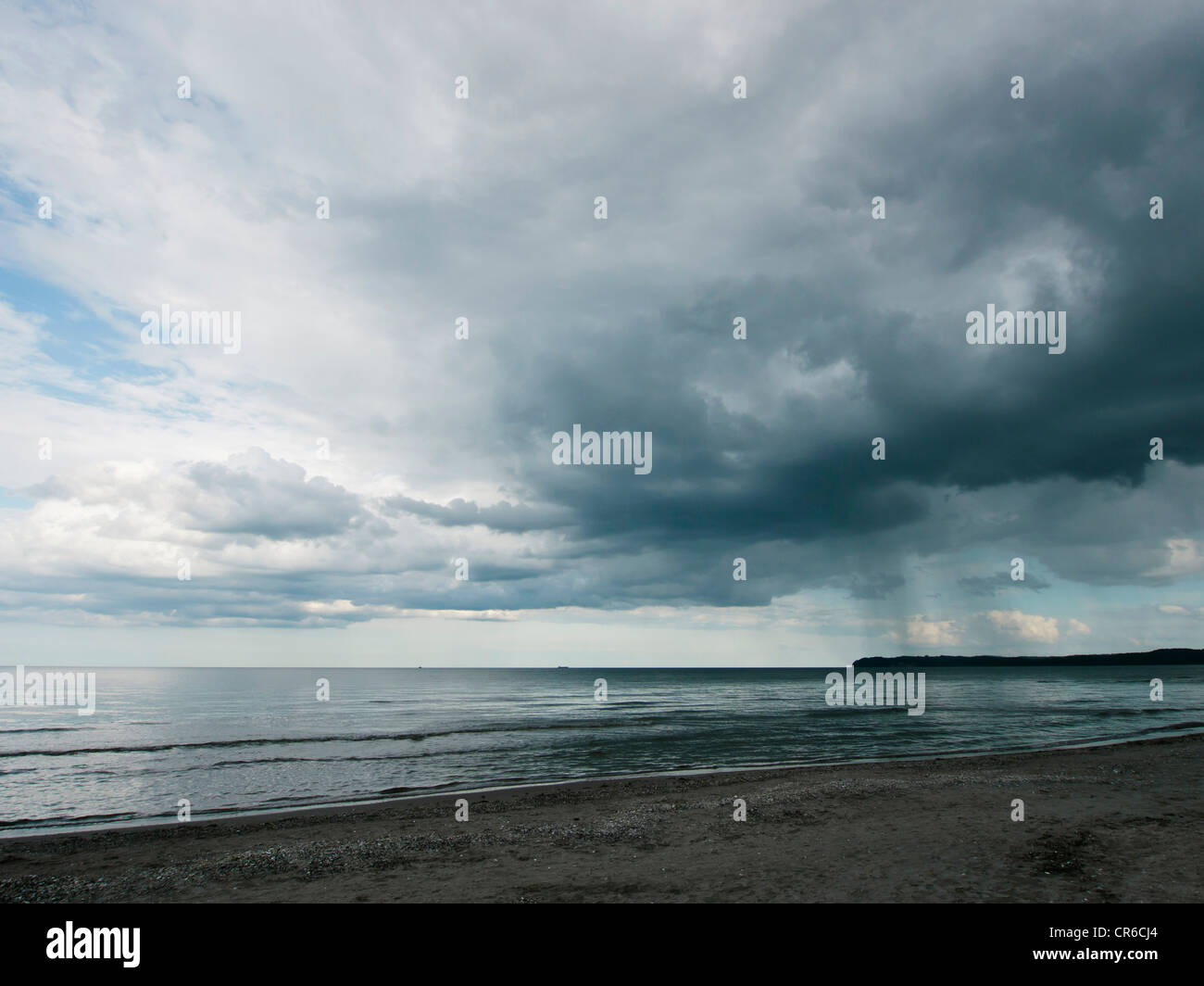 Germany, View of cloudy sky over Baltic Sea at Rugen Island - Stock Image