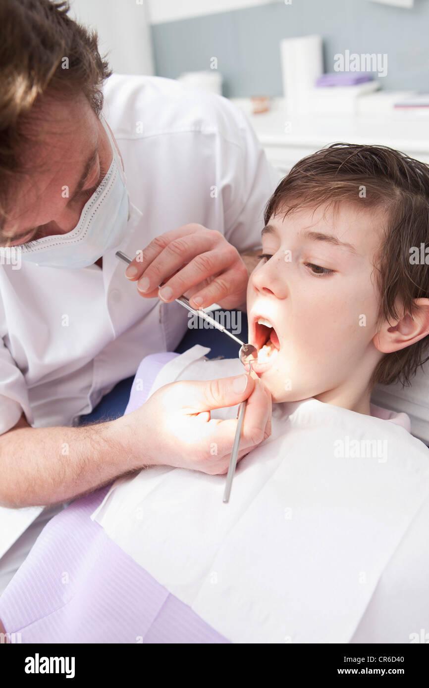 Germany, Bavaria, Dentist examining patient - Stock Image