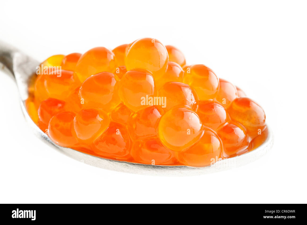 Fresh red caviar on a spoon - Stock Image