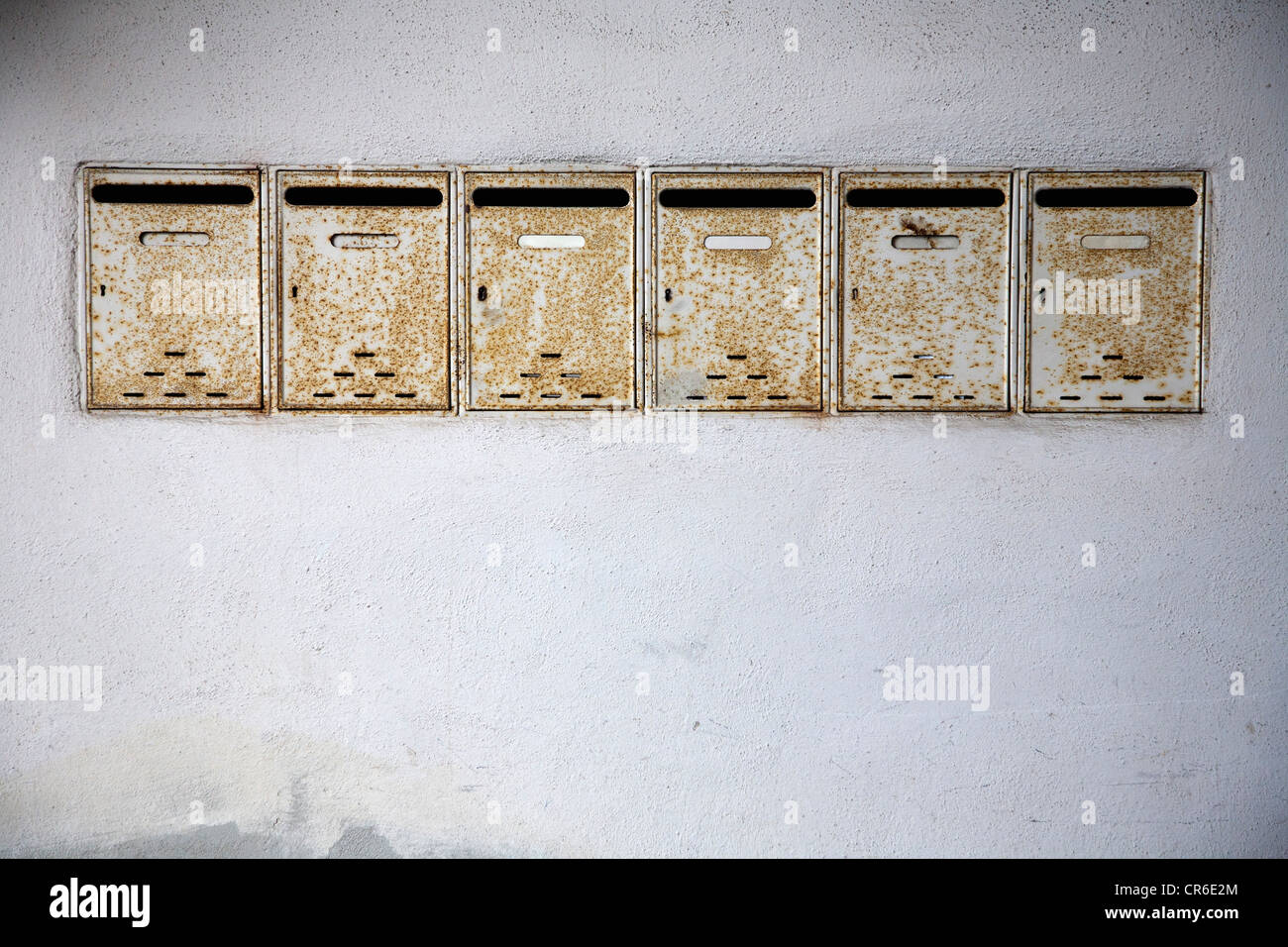 Germany, Bavaria, Wuerzburg, Row of old rusty mailboxes - Stock Image