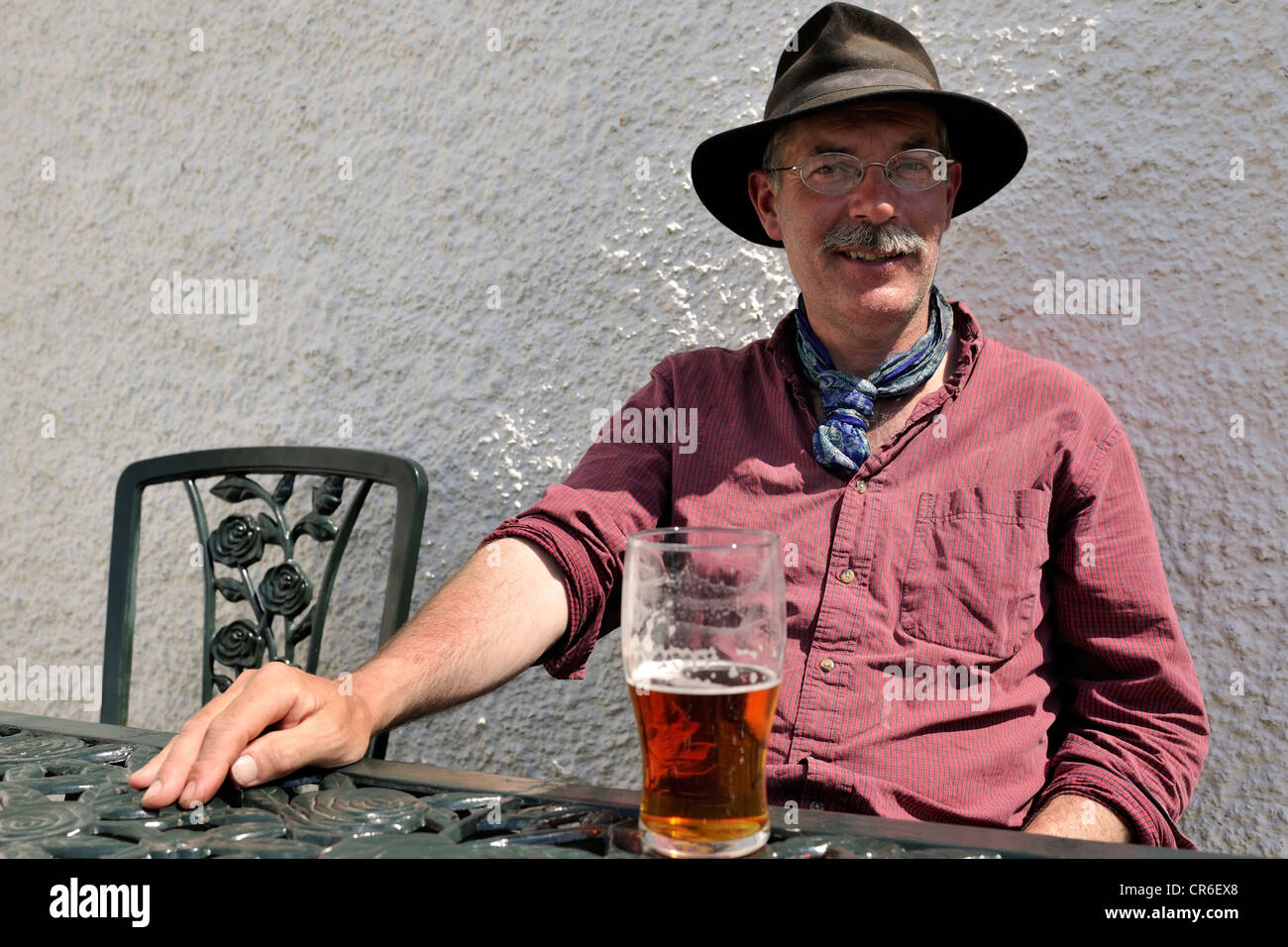 Cornish traveller relaxing at the Moorcock Inn, Garsdale Head, Yorkshire, England - Stock Image