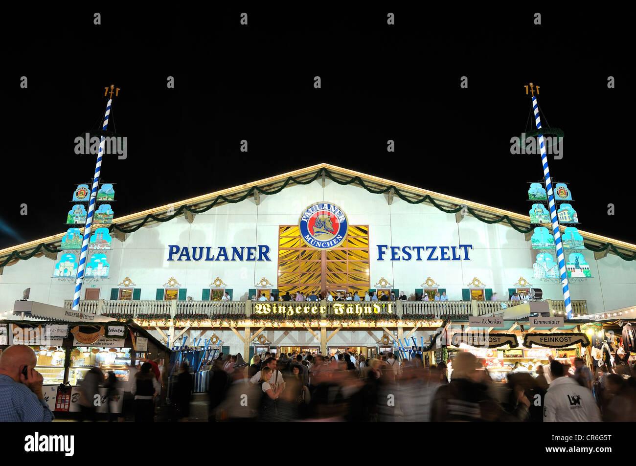 Brightly illuminated Paulaner Brauerei Winzerer Faehnd'l festival tent at night, Oktoberfest 2010, Munich, Upper - Stock Image