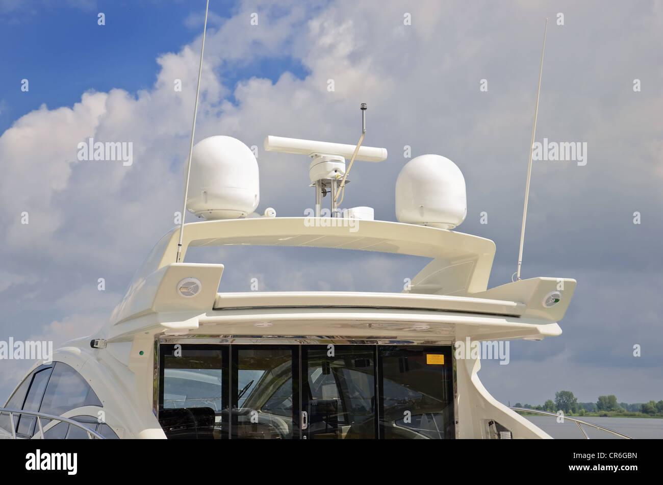 Marine communication radar antenna system on luxury boat - Stock Image