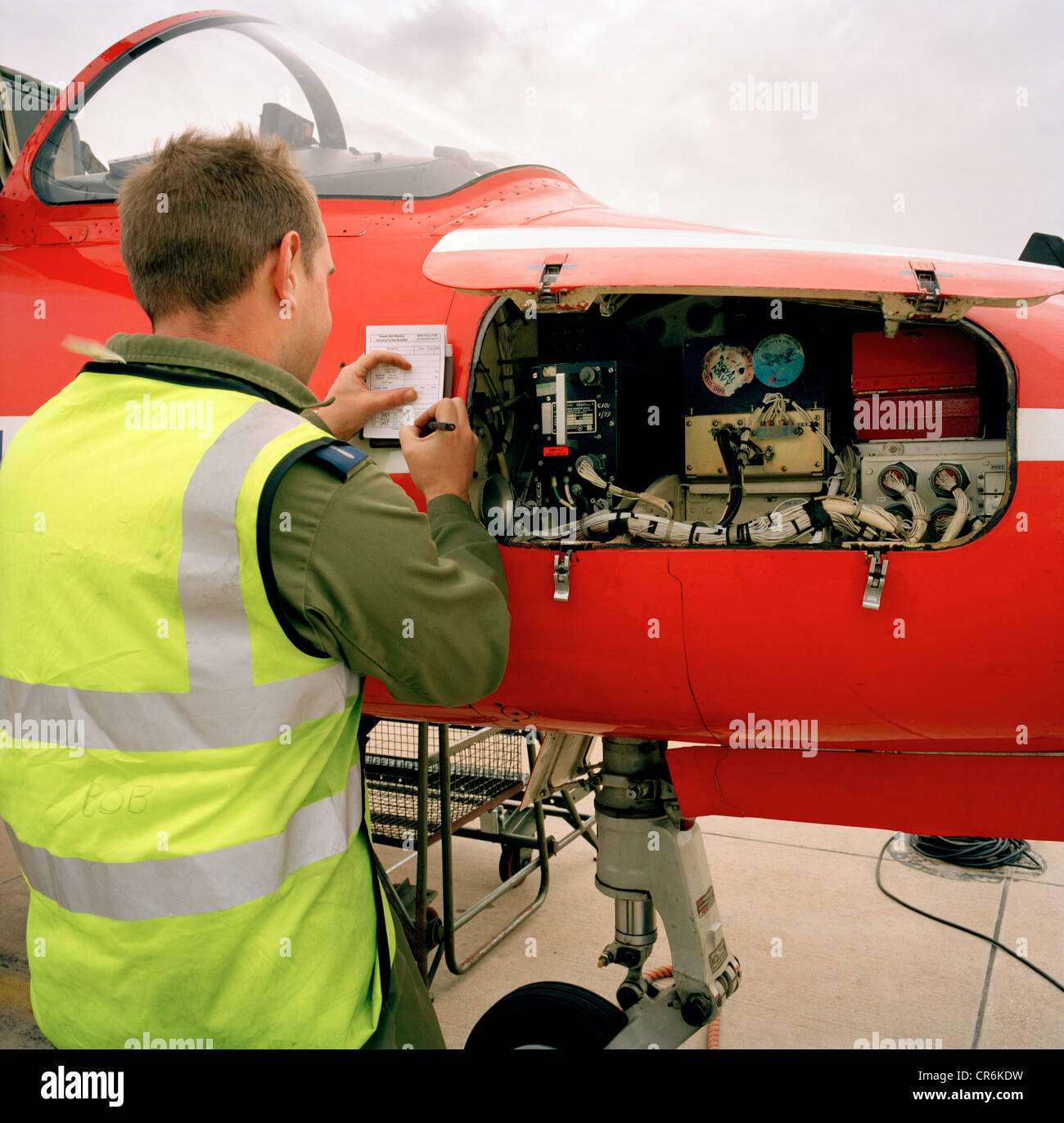 Engineering ground staff of the Red Arrows, Britain's RAF aerobatic team makes avionics notes on Hawk T.Mk.1 - Stock Image