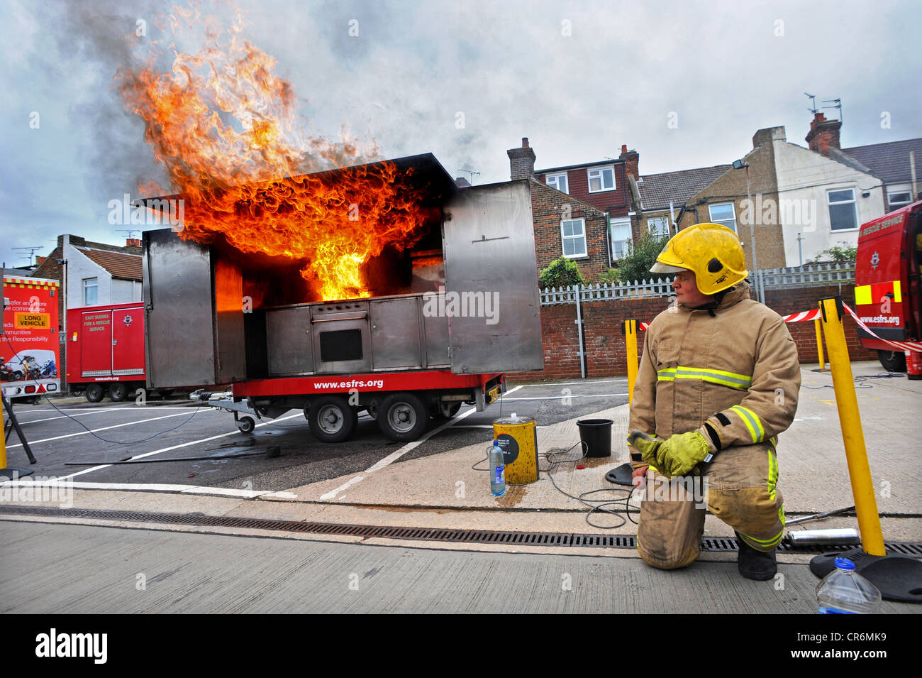 Chip pan fire demonstration by East Sussex Fire and Rescue during an open day at Eastbourne Fire Station - Stock Image