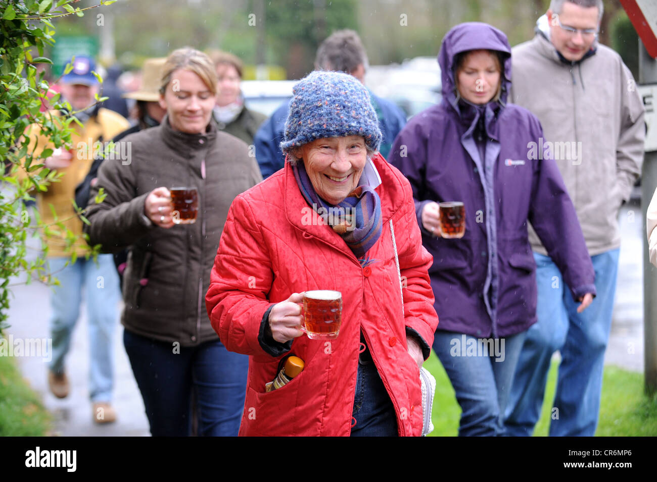 Villagers from Isfield taking part in the annual Laughing Fish Easter Monday Beer Race Stock Photo