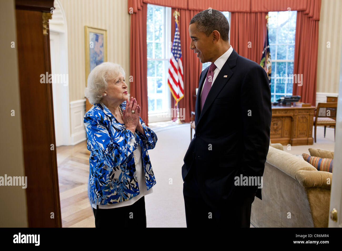 US President Barack Obama talks with acclaimed actress Betty White in the Oval Office of the White House June 11, - Stock Image