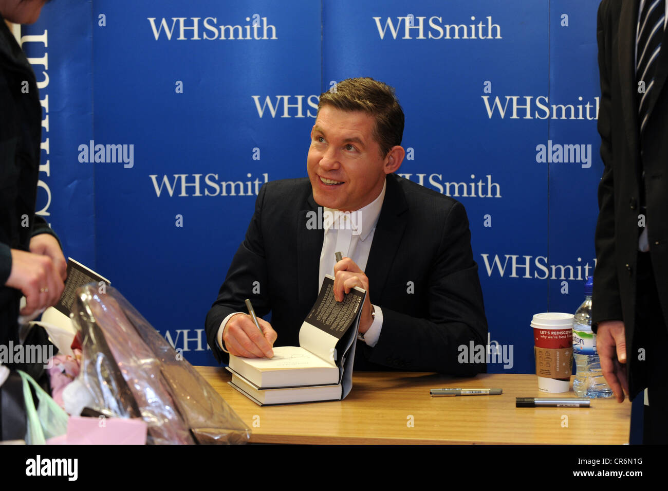 Comedian Lee Evans signing copies of his autobiography 'RoadRunner' at WHSmith in Brighton - Stock Image