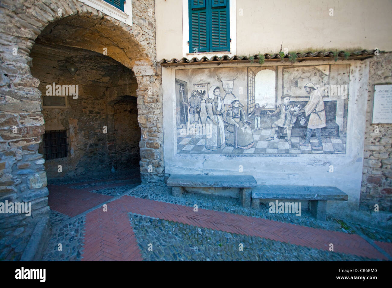 Wall painting with medieval motifs on the town square, , Imperia province, Riviera di Ponente, Liguria, Italy, Mediterranean - Stock Image
