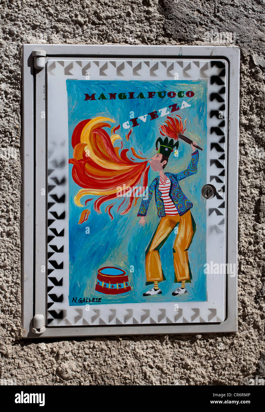Fire eater, typical tile image on a house of the artists' village , Imperia province, Riviera di Ponente, Liguria, - Stock Image