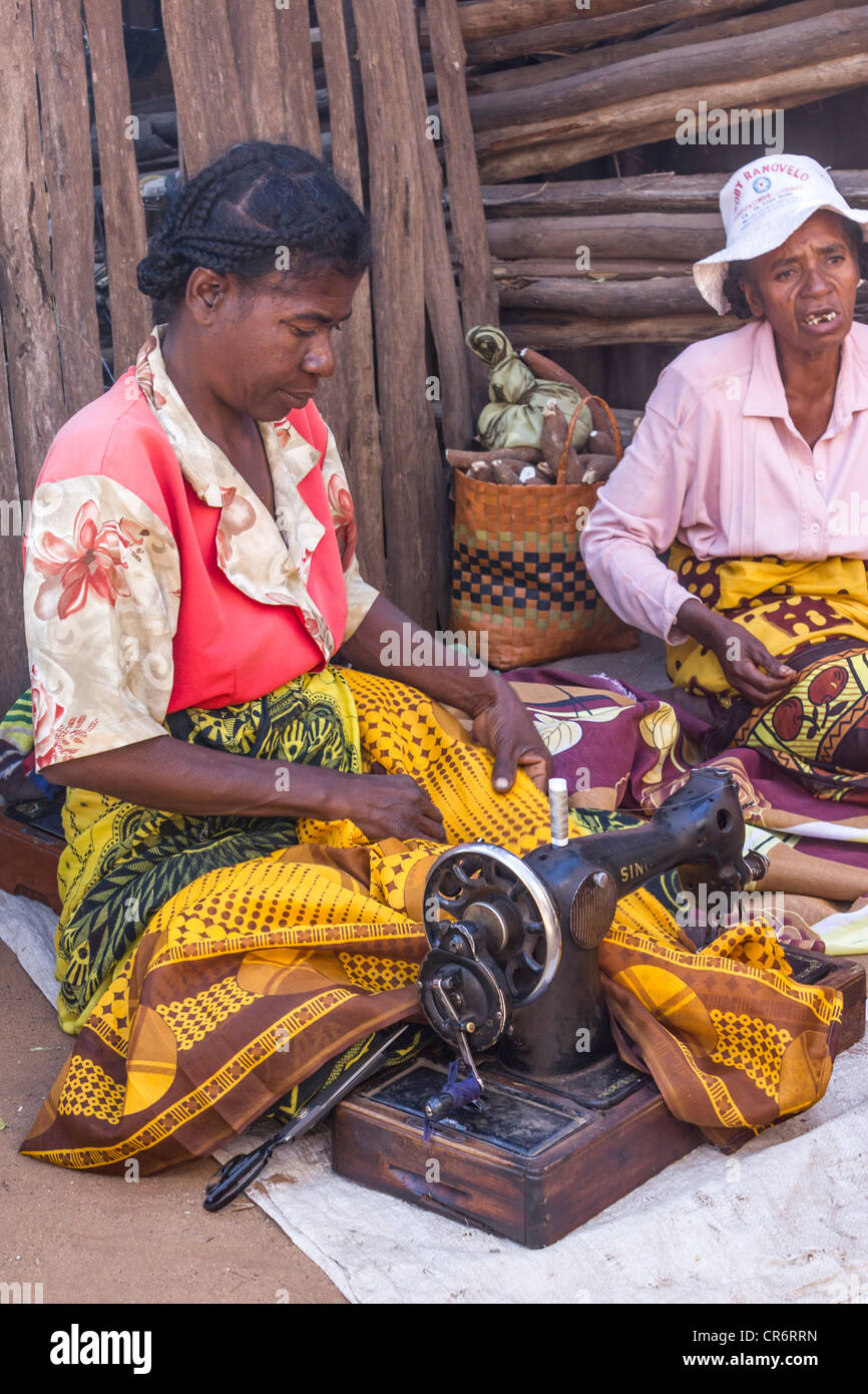 seamstresses working at sewing machine at market day, village near Berenty Reserve, Madagascar - Stock Image