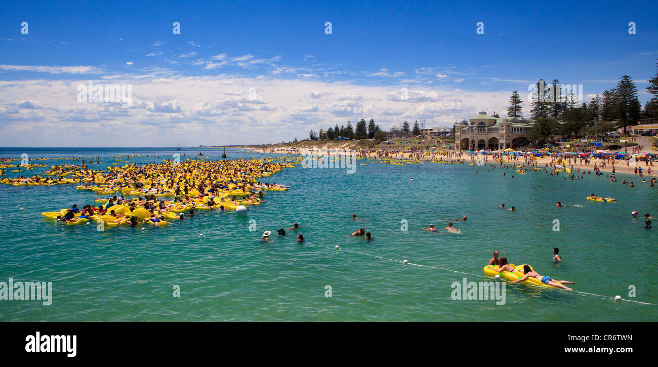 People with inflatable during the Havaianas Thong Challenge World Record attempt on Australia Day 2012 - Stock Image